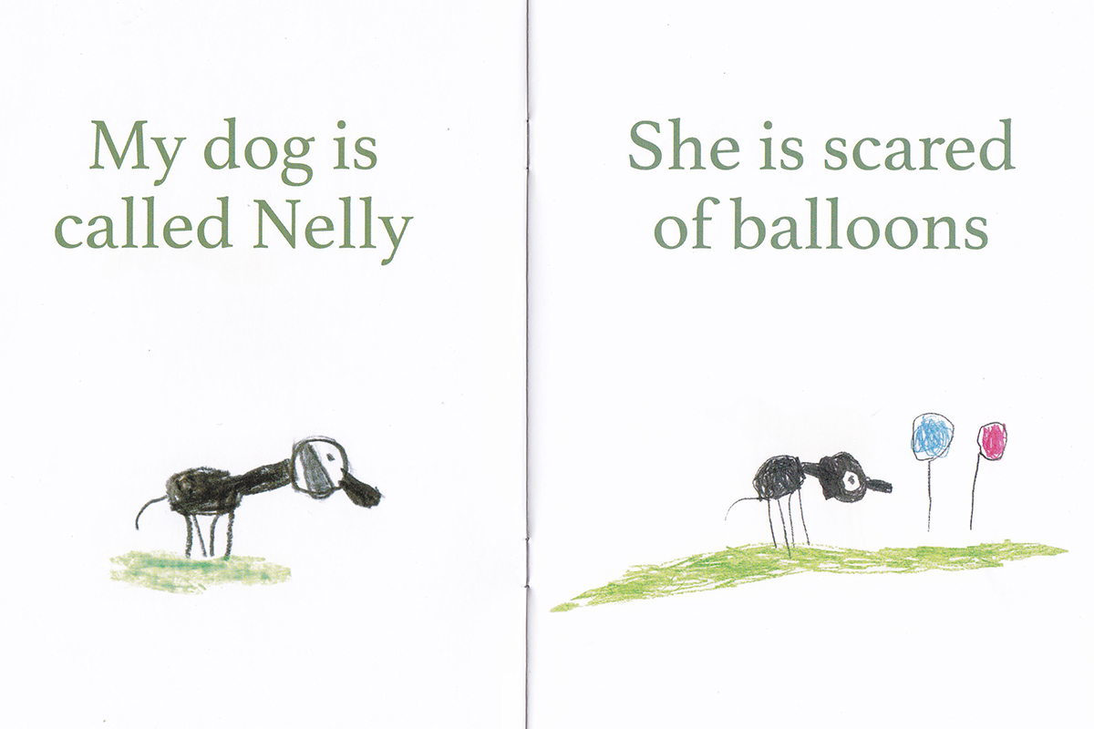 Page from book with drawing and text about Nelly the dog