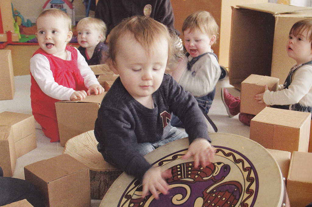 Toddlers playing with musical instruments and boxes - Lullaby project by Kids Own