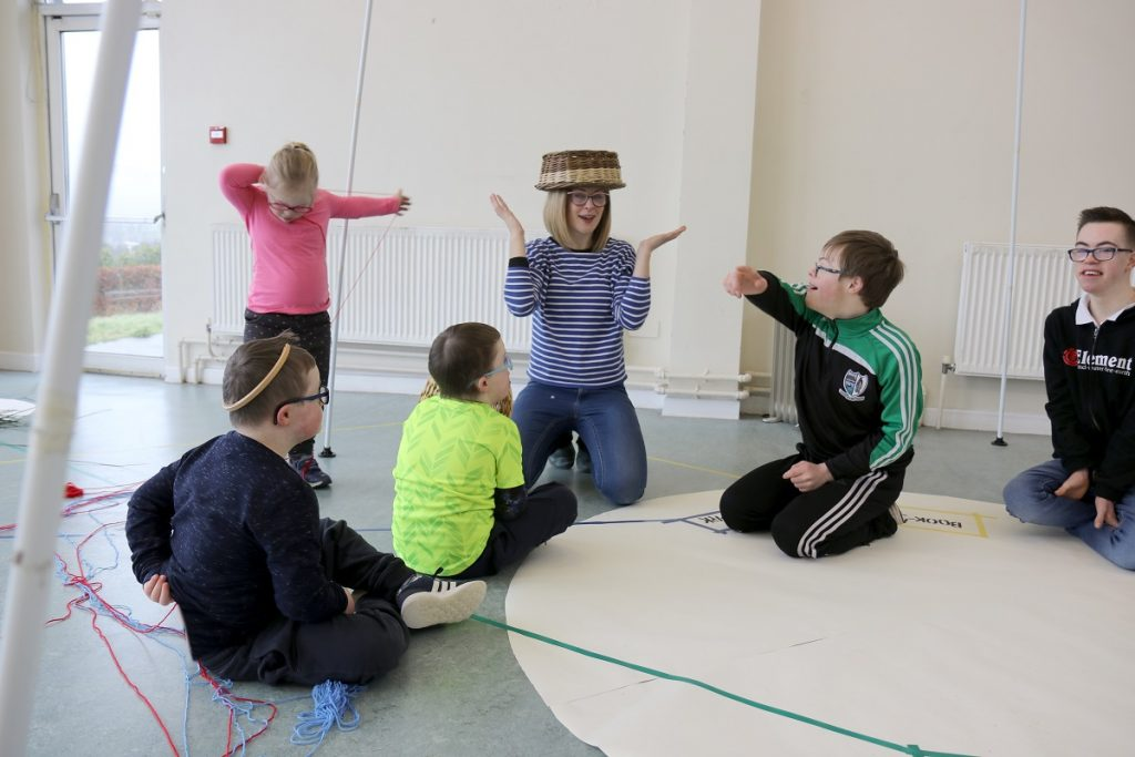Naomi talks and plays with some of the children at the start of our creative session.