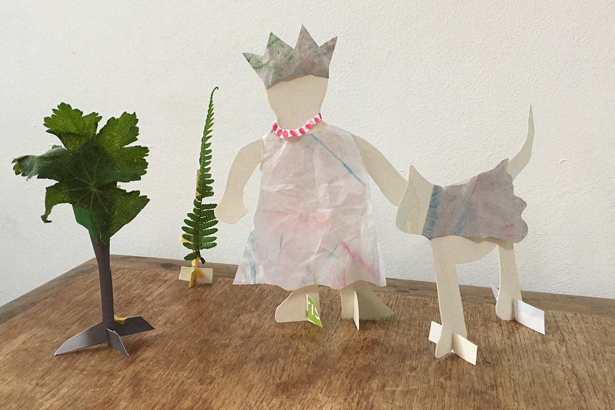 Standing person with dog made out of paper - Reinventions project from Kids Own
