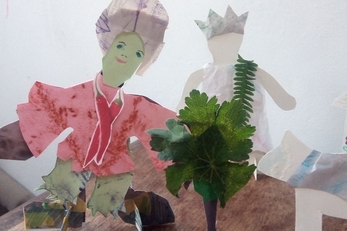 Two paper people with fern bush - reinventions project from Kids Own