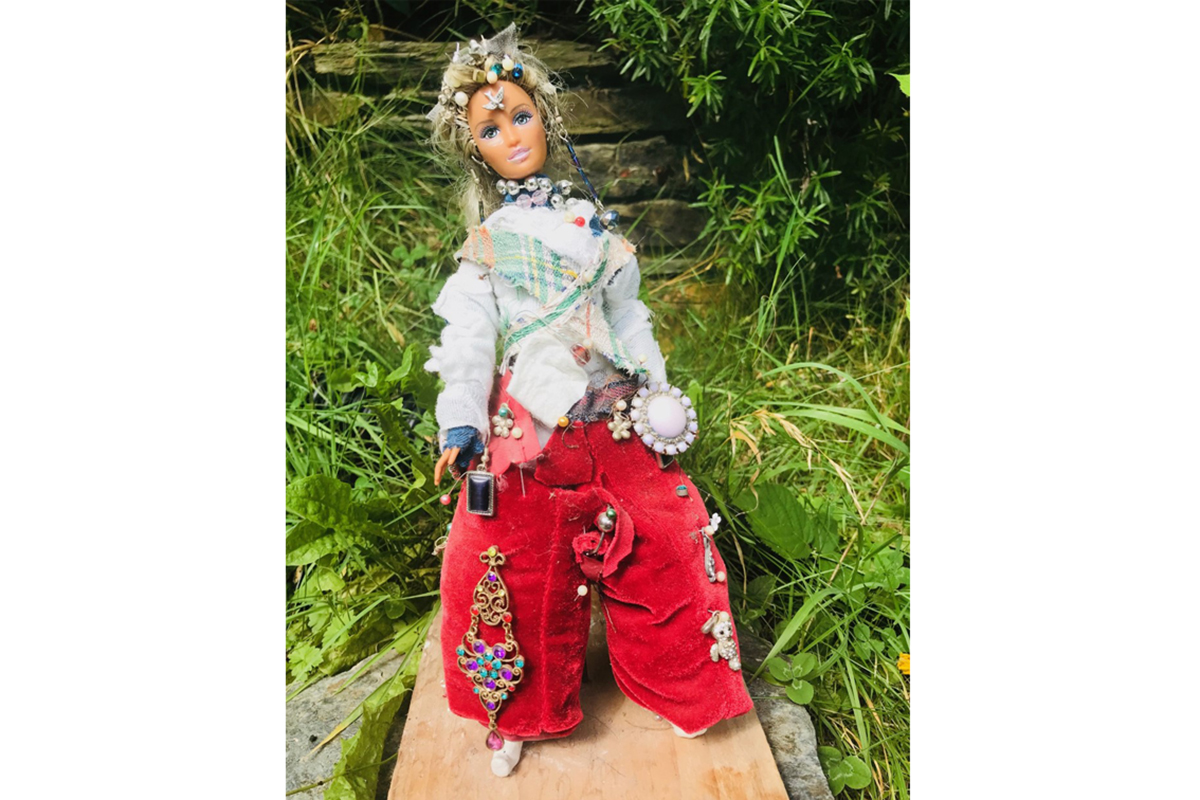 Doll with handmade clothes and jewellery - reinventions upcycling project of Kids Own Publishing