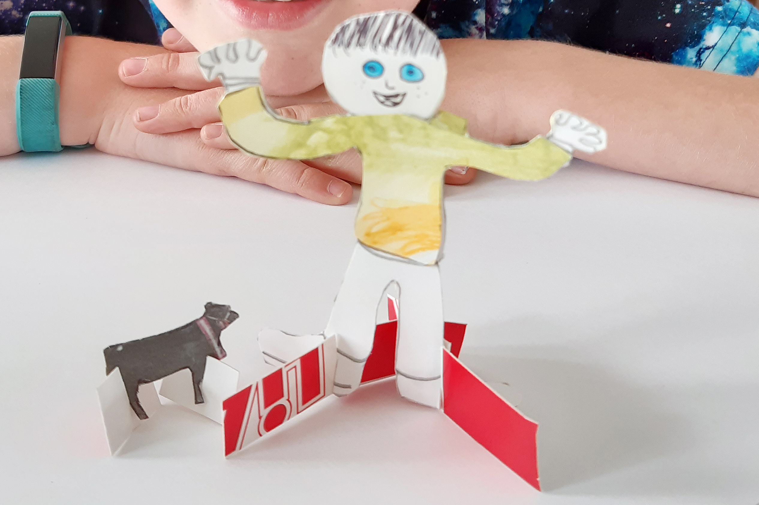 A paper man and dog from Kids own publishing art project with children