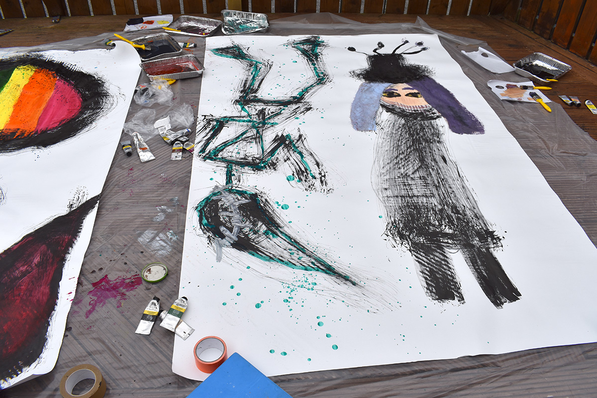 Large scale self portraits in LGBTQIA+ art project for teens